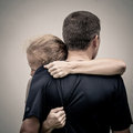 Sad woman hugging her husband women at the day time Royalty Free Stock Images