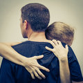 Sad woman hugging her husband women at the day time Stock Photos