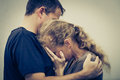 Sad woman hugging her husband women at the day time Royalty Free Stock Image
