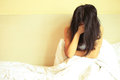 Sad woman sit on bed Royalty Free Stock Photo