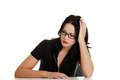 Sad woman sitting behind the desk Royalty Free Stock Photo
