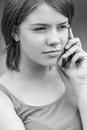 Sad woman talking on cell phone beautiful young gray background Stock Image