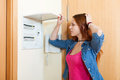 Sad woman turning off the light switch at home Stock Photos