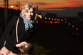 Sad young blond woman against a night city lights Stock Images