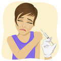 Sad young woman getting vaccination procedure