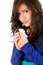 Sad young woman with tissue Stock Image