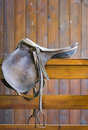 Saddle on a railing Stock Photos