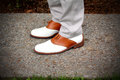Saddle shoes nice new clean classic on sidewalk shallow depth of field Stock Image