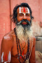 Sadhu holy man in varanasi india june portrait of an with traditional painted face praying near by the gange india Royalty Free Stock Photos