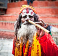 Sadhu play flute at pashupatinath temple in kathmandu nepal the two primary sectarian divisions community are shaiva Royalty Free Stock Image