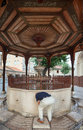 Sadirvan ablutions fountain sarajevo bosnia and herzegovina august man refreshes on the the of the gazi husrev beg mosque Stock Photography