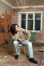 The sadness man sit on chair old metal in dirty room Stock Image