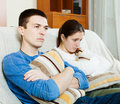 Sadness man and unhappy woman having problems men women at home Royalty Free Stock Image