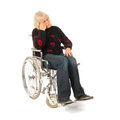 Sadness woman of mature age in wheel chair isolated over white background Stock Images