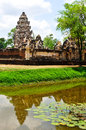 Sadok kok thom stone castle khmer art with reflection pond thailand rocks at ancient city in religious buildings Stock Photo