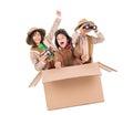 Safari children in a cardboard box playing Stock Photos