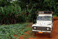 Safari jeep on dirt road Stock Images