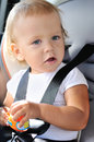 Safety for baby girl in car seat Stock Photos