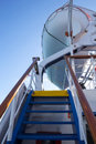 Safety on board vertical shot of stairs to a lifeboat a ferry Royalty Free Stock Image