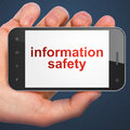 Safety concept information safety on smartphone hand holding with word display mobile smart phone blue background d render Stock Photos