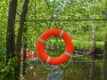 Safety equipment, lifebuoy or rescue buoy hanging on the fence near the boat station