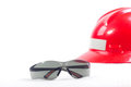 Safety eyeglasses and safety helmet. Royalty Free Stock Photo