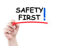 Safety first hand writing text on transparent wipe board with white background and copy space Royalty Free Stock Photography