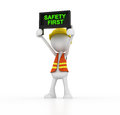 Safety first a man holding up sign Stock Image