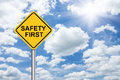 Safety first sign on blue sky Royalty Free Stock Photo