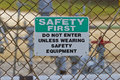 Safety first sign at natural gas production site warning oil well head Royalty Free Stock Photo