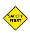 Safety First sign on a white Royalty Free Stock Photo