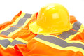 Safety first vest and hard hat on white background Stock Images