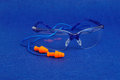 Safety goggles and ear plugs Royalty Free Stock Photo