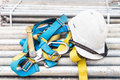 Safety harness and helmet at a construction site Stock Image