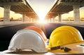 Safety helmet on civil engineering working table against bridge Royalty Free Stock Photo