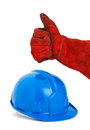 Safety helmet and hand with red glove expressing positivity with ok symbol the photo is intended to convey a positive concept of Royalty Free Stock Photo