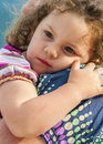 Safety little girl in her mother arms Royalty Free Stock Photos
