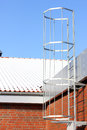 Safety metal ladder to the roof and blue sky Royalty Free Stock Photo