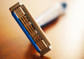 Safety razor on wooden background Royalty Free Stock Photo