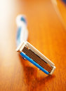 Safety razor on wooden background Stock Photo