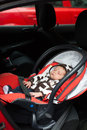 Safety seat baby sleeping in car Royalty Free Stock Photos