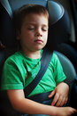 Safety seat and belt child sleeping in car wearing Royalty Free Stock Photos