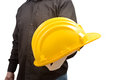 Safety in the workplace engineer giving a protective helmet with his hand concept of Royalty Free Stock Photo