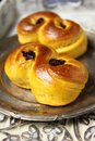 Saffron buns sweet swedish baked with cranberries and raisins Stock Photos
