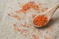 Saffron crimson stigmas in an olive wood spoon on a sackcloth Royalty Free Stock Image