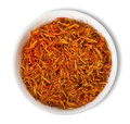 Saffron in plate on white background Royalty Free Stock Image