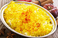 Saffron rice as closeup in a traditional bowl Royalty Free Stock Photos