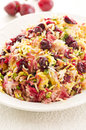 Saffron rice with sour cherries as closeup on a white plate Stock Photo