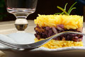 Saffron rice with trevisano chicory served on a grey plate selective focus Stock Photos