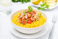 Saffron rice with tuna tomatoes peppers and herbs in a bowl horizontal Stock Image